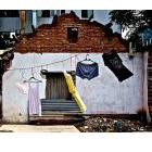 Dilapidated building with laundry on the clothesline