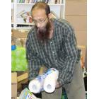 Headshot of Thorncliffe food bank coordinator Zeeshan Modi sorting food and daily use items for food bank clients