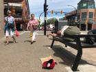 Homeless man sleeping on a bench outside Penticton Farmers Market