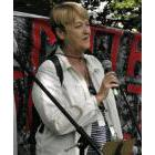 Toronto street nurse Cathy Crowe addresses anti-poverty activists at Allan Gardens in Toronto Aug. 19