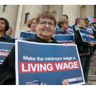 Rally on the steps of the Manitoba Legislature for an increase to the province's minimum wage