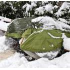 Seems to be a person in a sleeping bag under a tarp under a garbage bag under some snow
