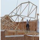 Hoisting trusses onto a roof
