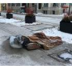 Man is a sleeping bag on the sidewalk in Toronto on December 31, 2017