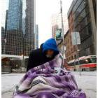 Homeless person on the sidewalkin front of the City Hall in Toronto