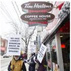 Protesters gather outside of a Tim Hortons in Halifax