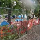 Homeless camp viewed through a fence