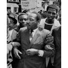 Martin Luther King Jr, arm-in-arm with protesters