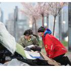 Vision Coun. Andrea Reimer and Rena Kendall-Craden, Vancouver's director of corporate communications, speak to one of the city's homeless during the 2016 count