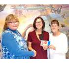 Nicole Combres, executive director of the Battlefords Boys and Girls Club, accepts a cheque in 2016