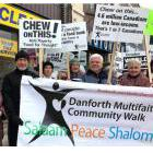 Politicians and religious leaders lead the Danforth Multifaith Community walk in Toronto on Oct. 21