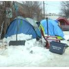 Tents set up in a parking lot in Fredericton