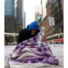 Homeless person on a sidewalk in Toronto