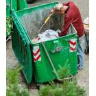 Man sorting through a dumpster