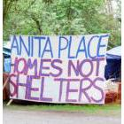 Banner at the Anita Place tent city