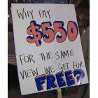 Sign reading 'Why Pay $550 for the Same View We Get For Free?'